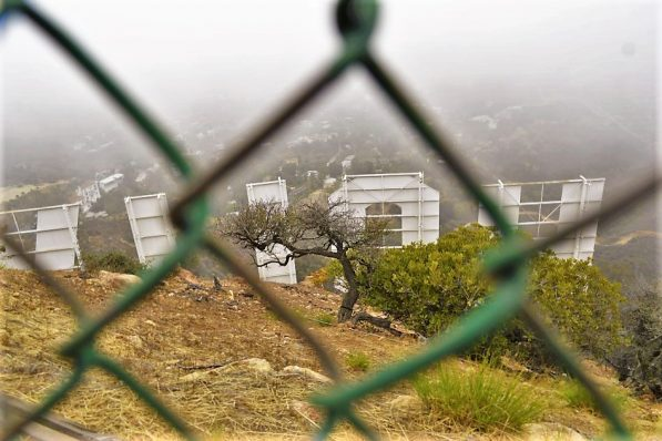 First view of the Hollywood Sign, fence, Hollywood Sign hike, Los Angeles, USA