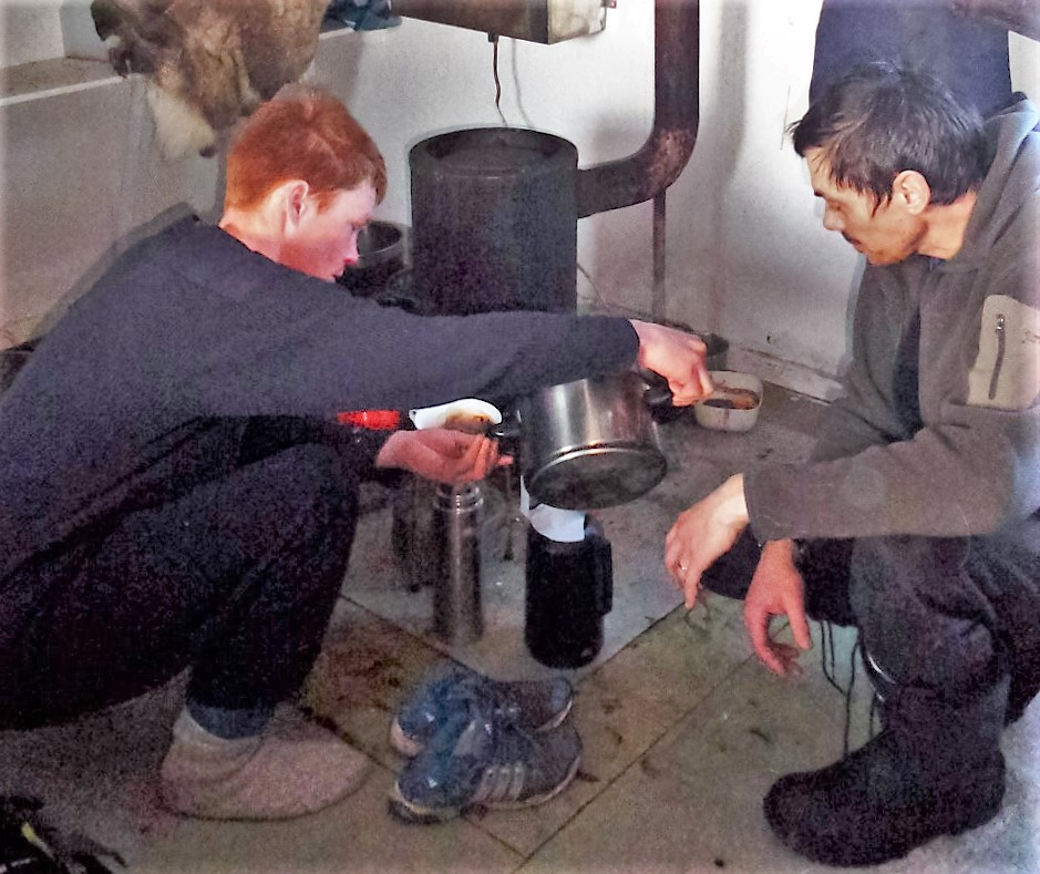 Expedition breakfast coffe over fuel heater in Greenland