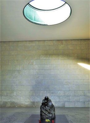 Neue Wache memorial of woman in dark room in Berlin, Germany