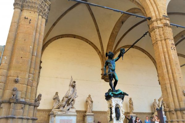 Palazzo Vecchio statues and tourists, Florence, Italy