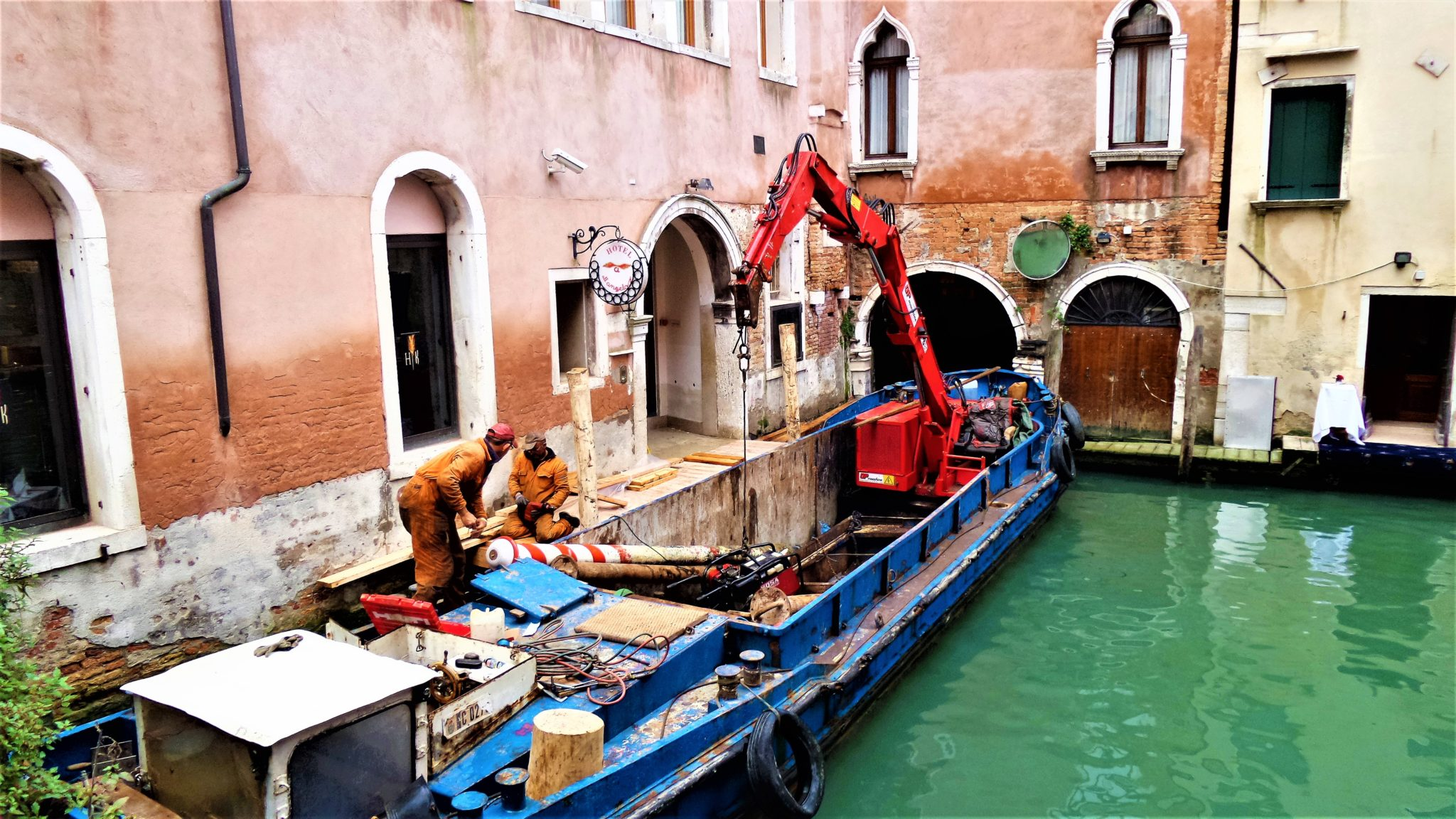 Construction workers, Builders in Venice, Italy